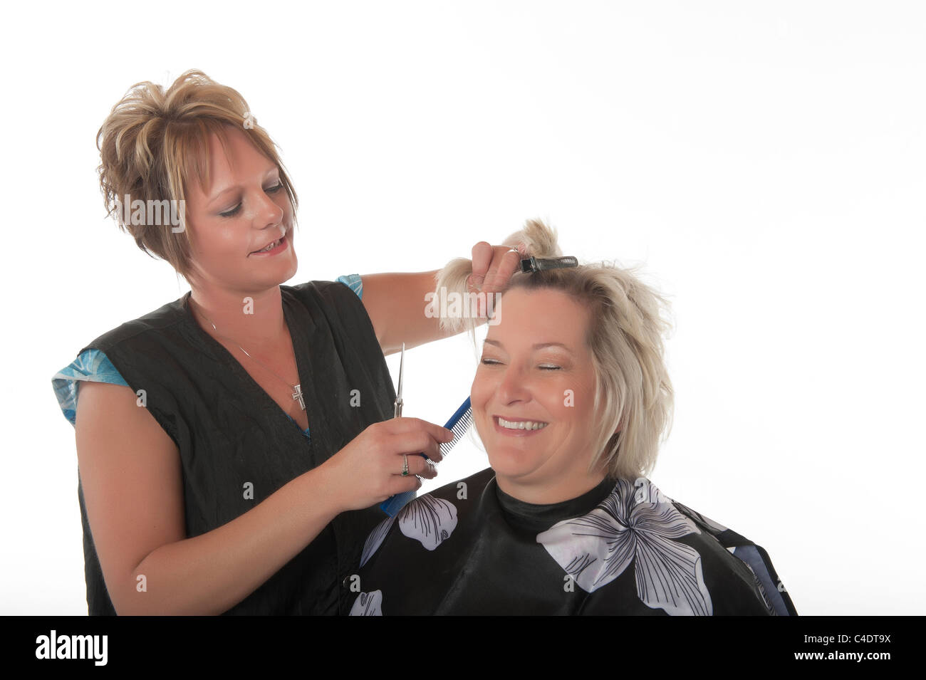 Hair stylist at work - Stock Image