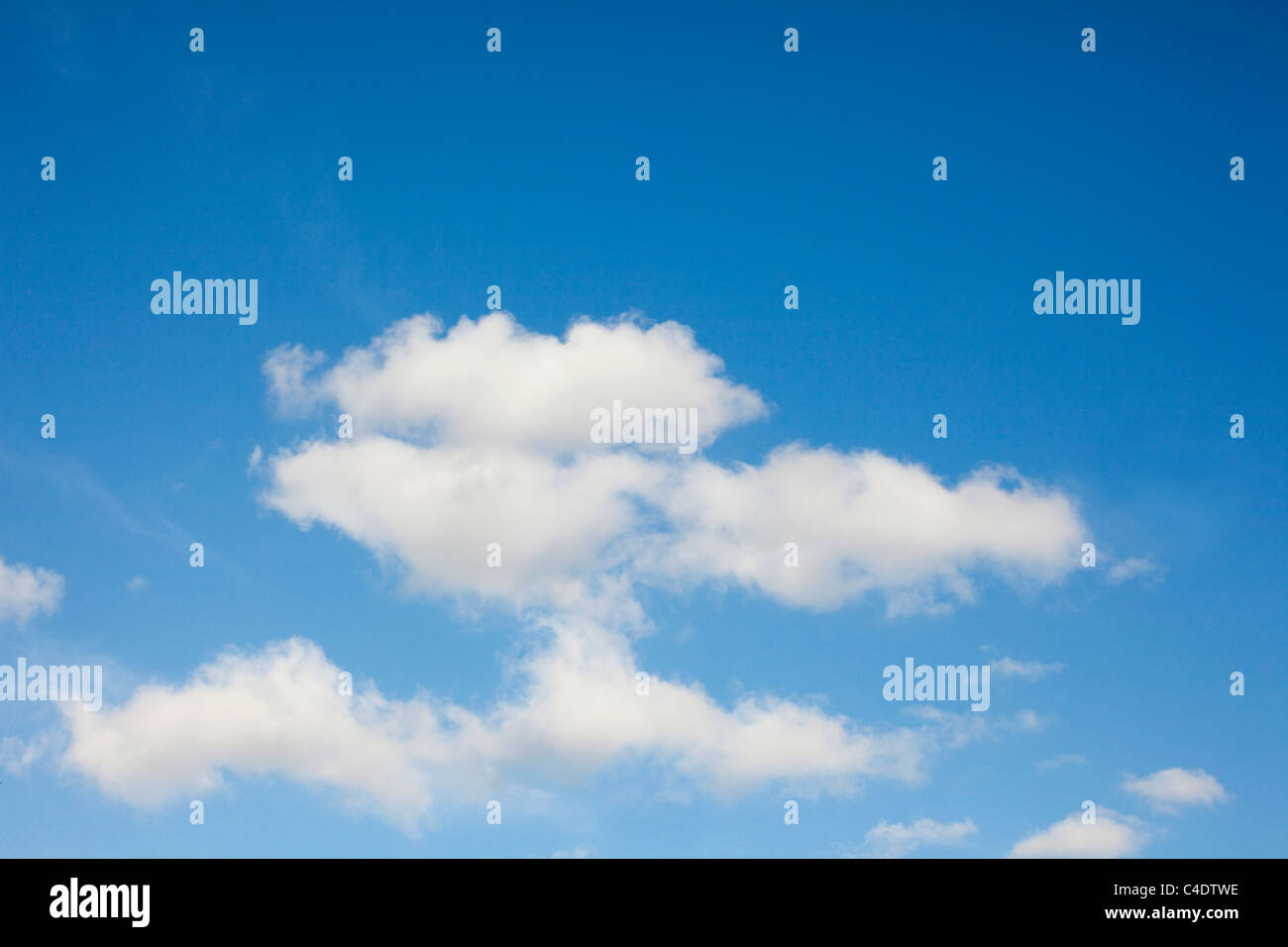 unusual cloud formation in a blue sky - Stock Image