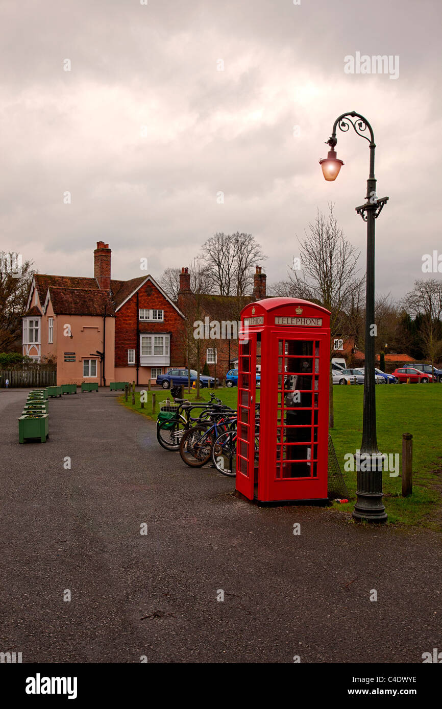 A red K6 telephone box on the Cathedral Green in Salisbury, Wiltshire, England, UK Stock Photo