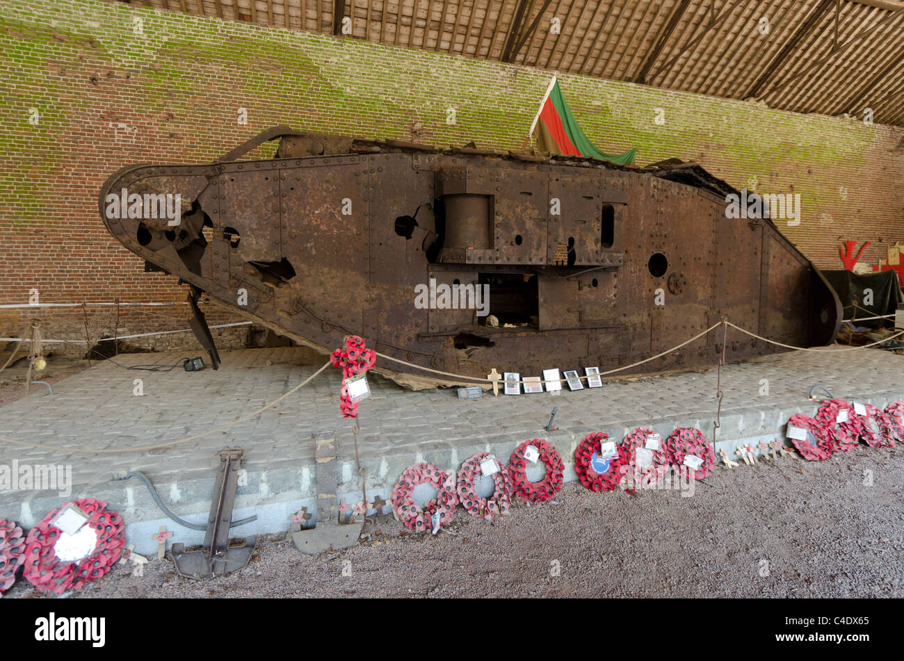 Destroyed First World War British tank on display in France - Stock Image