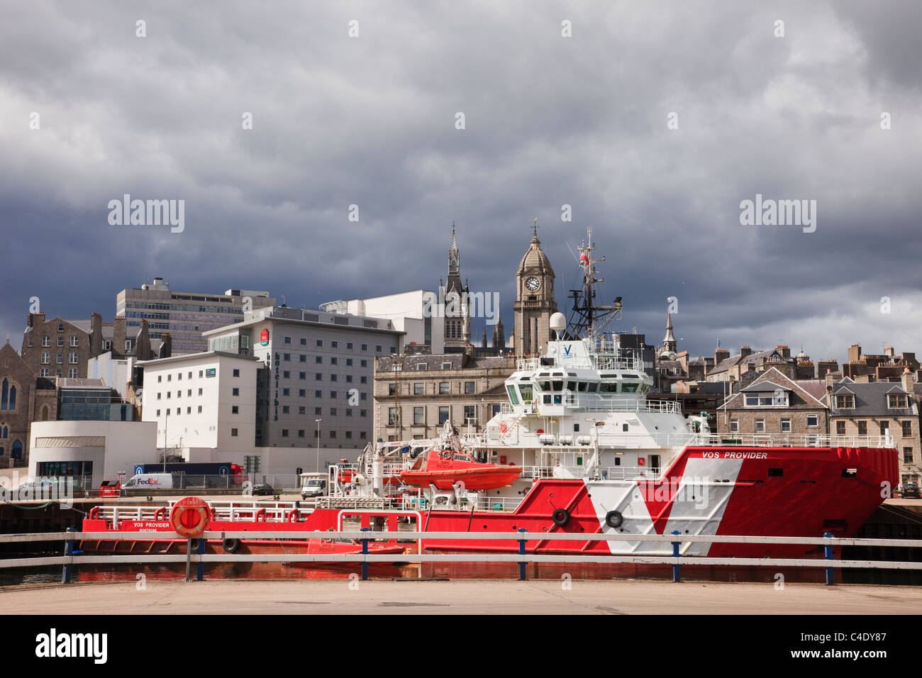 Aberdeen, Scotland, UK. VOS Provider a VROON shipping group North Sea offshore oil supply ship in dock with city - Stock Image
