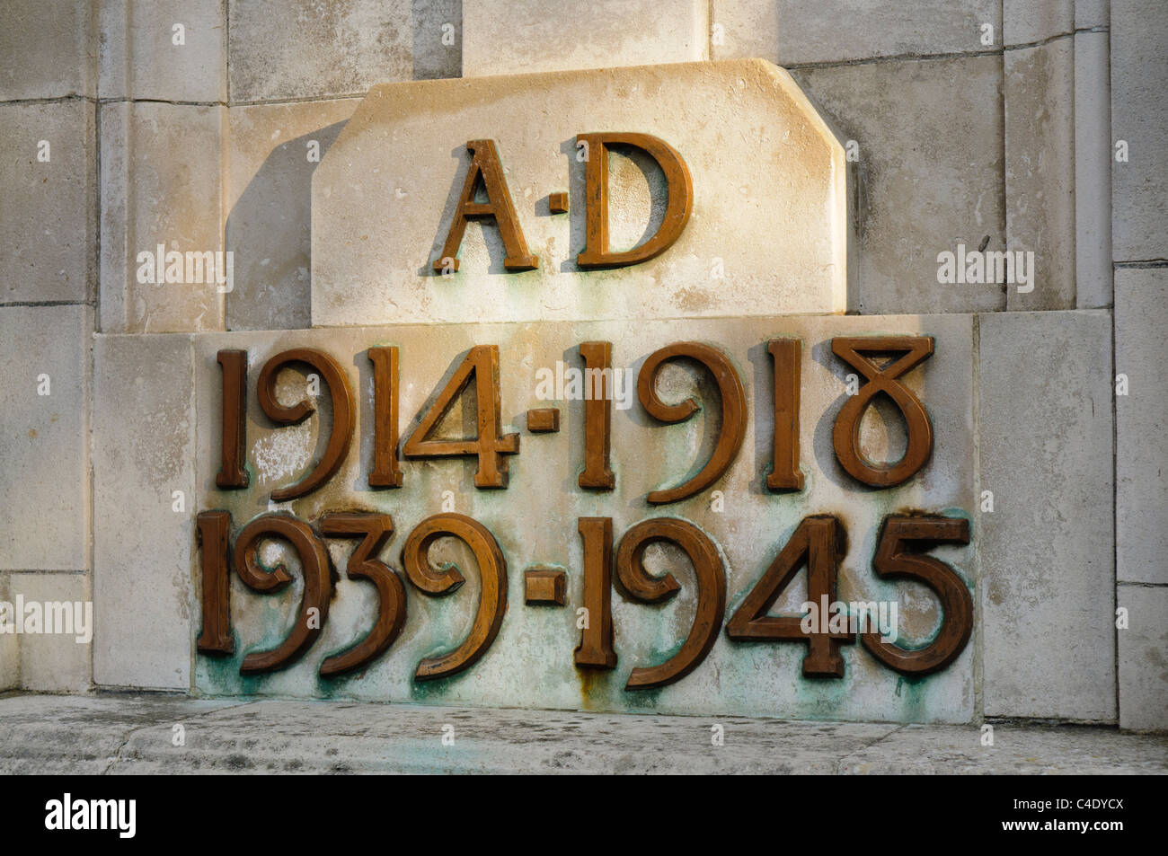Years of World War 1 and World War 2 on the base of a memorial to the two 2 world wars - Stock Image