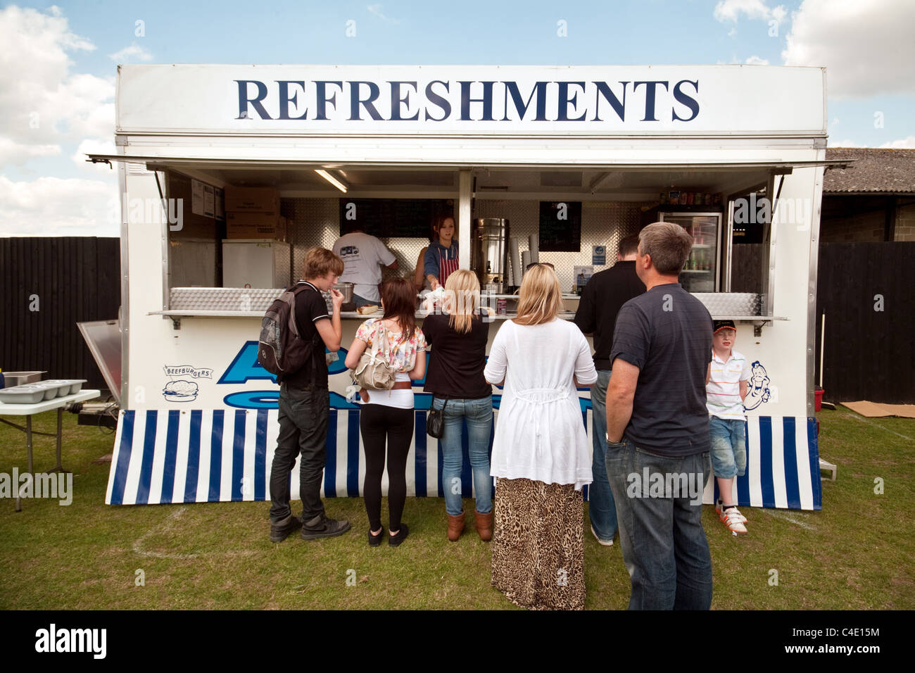 A queue at a refreshments stall - Stock Image
