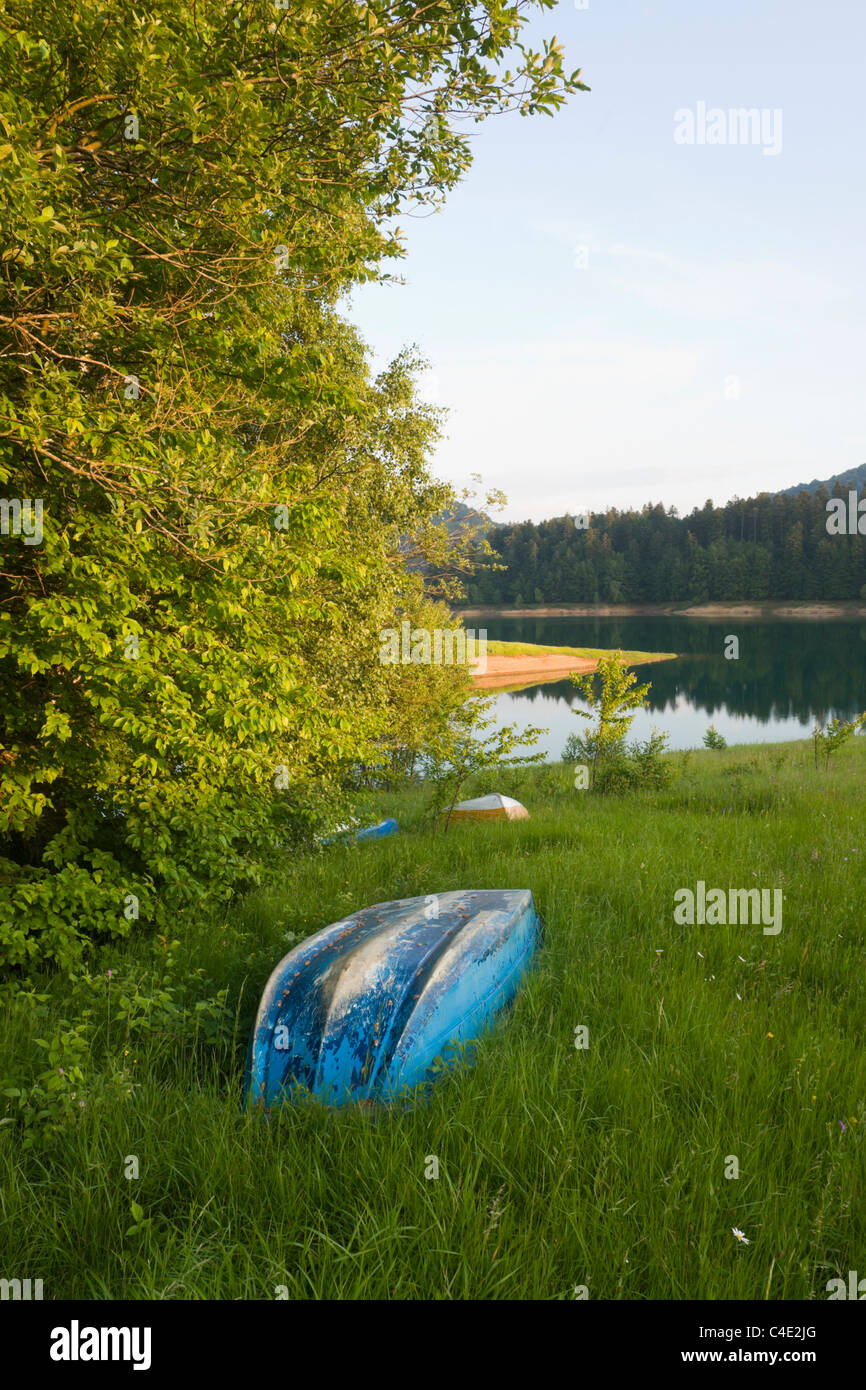 Boats laid ashore on the grass,  Lokve lake in Gorski Kotar, Croatia field lakeside Primorje-Gorski Kotar County in on at probably but near evidently Stock Photo