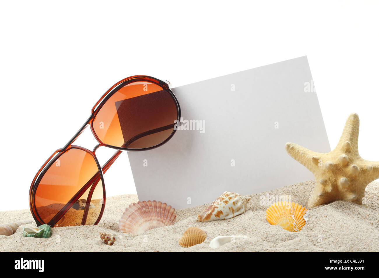 summer holidays memories card from beach with shells and sunglasses on sand - Stock Image