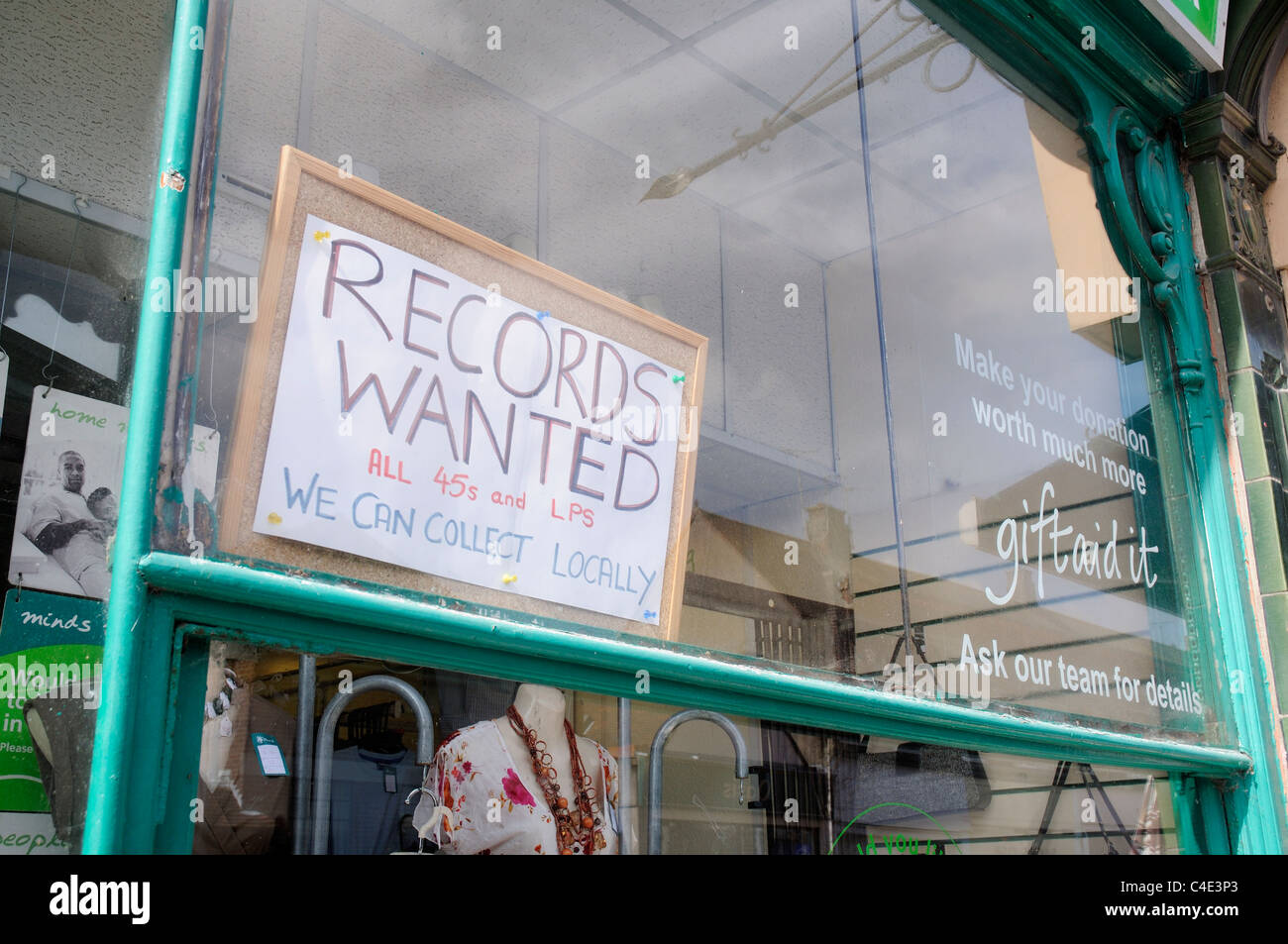 A sign 'Records Wanted' in a charity shop window - Stock Image