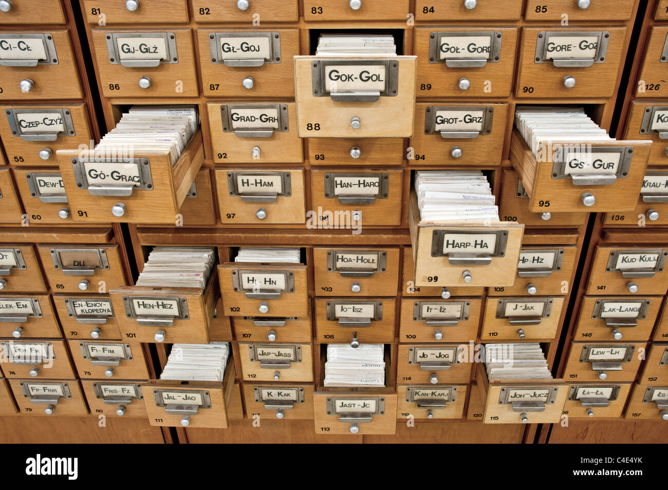 Old card catalogue in a library with some drawers opened - Stock Image