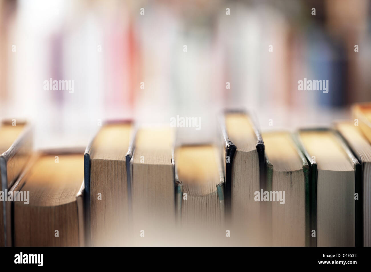 Books on a library shelf - Stock Image