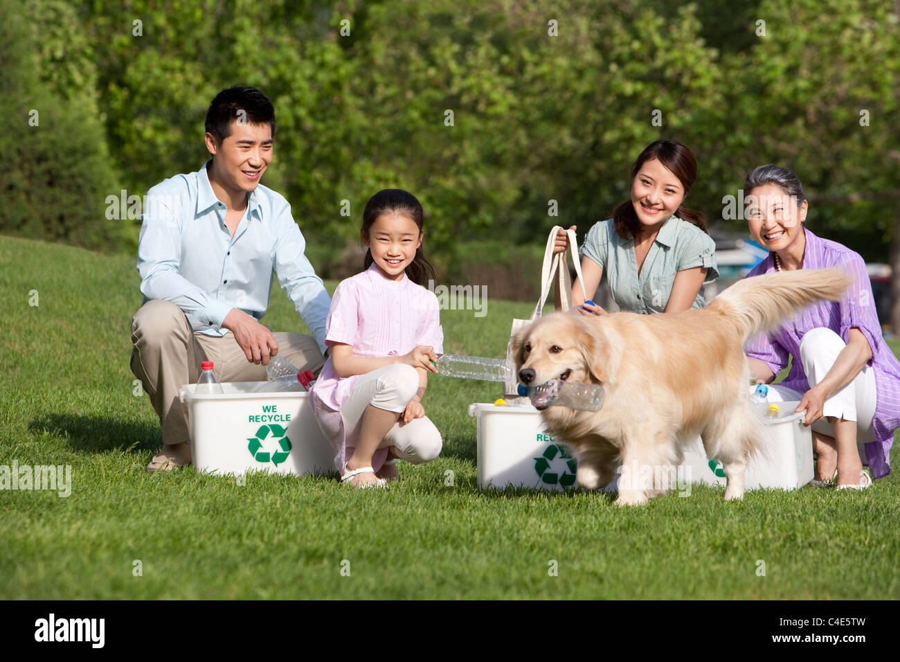 Family Recycling at the Park - Stock Image