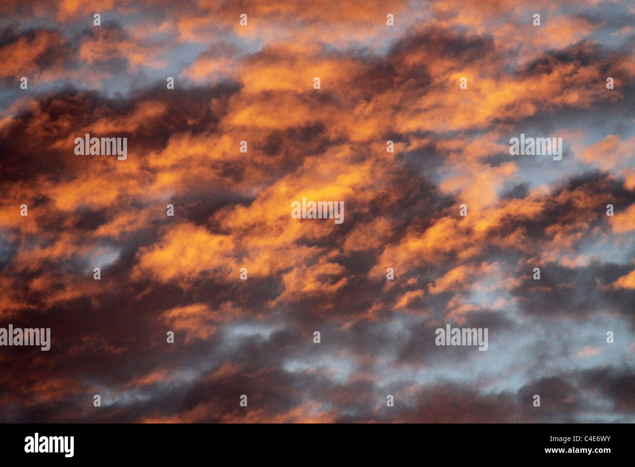 Golden yellow cloudy sky after rain - Stock Image