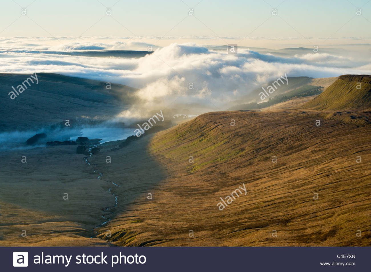 Mist swirls around the Upper Neuadd Reservoir, Brecon Beacons National Park, South Wales. - Stock Image