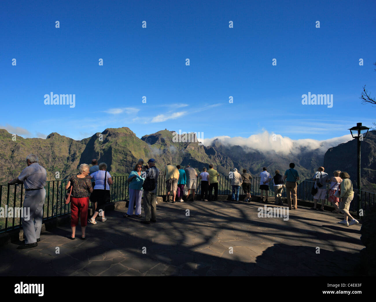 Tourists at Eira do Serrado, viewpoint overlooking the Nuns Valley , Madeira. - Stock Image