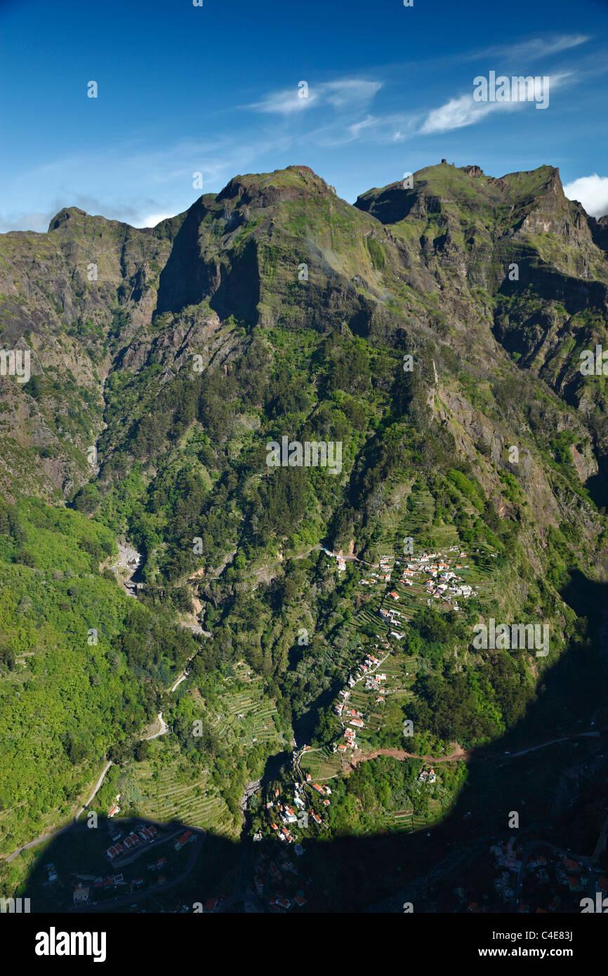 The mountain village of Curral das Freiras as seen from Eira do Serrado, Madeira. - Stock Image