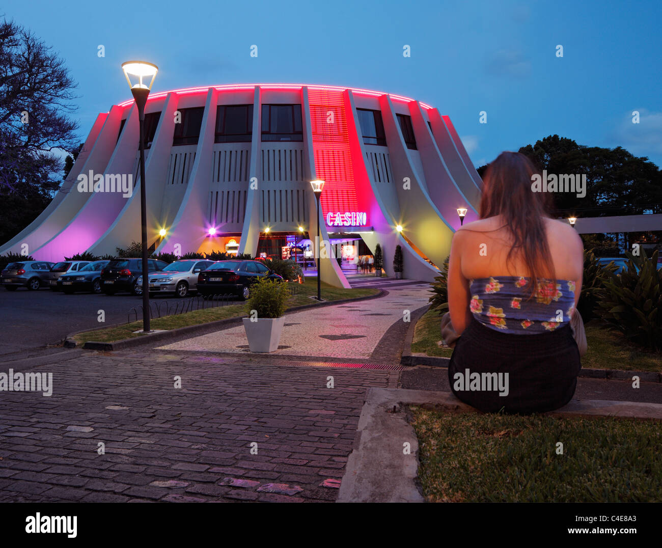 Woman sitting outside a Casino in Fuchal. - Stock Image