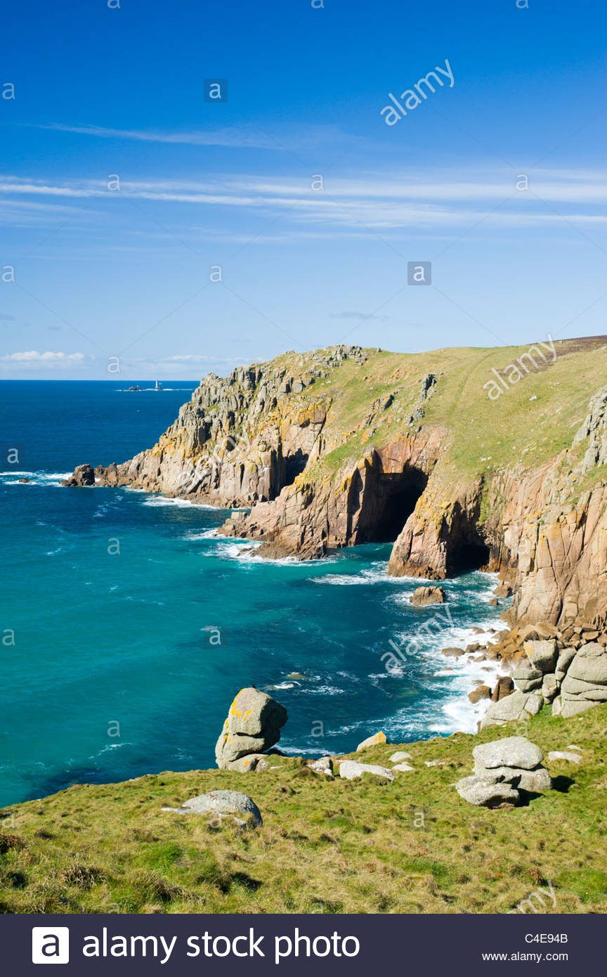 Looking out to the Longships lighthouse from near Land's End, Cornwall. - Stock Image