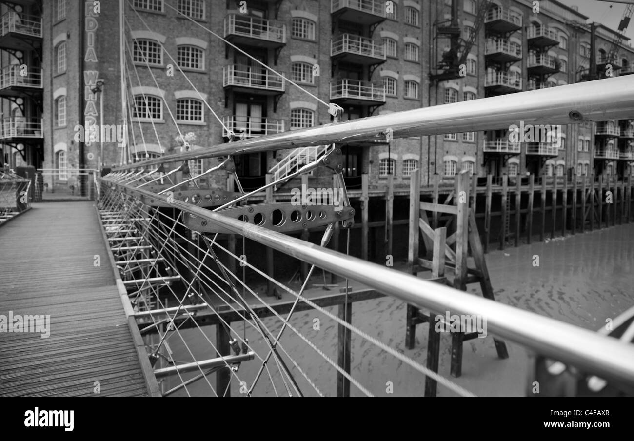 A detail of an old iron bridge an entrance to St. Savior's Dock, Shad Thames, London, UK. - Stock Image