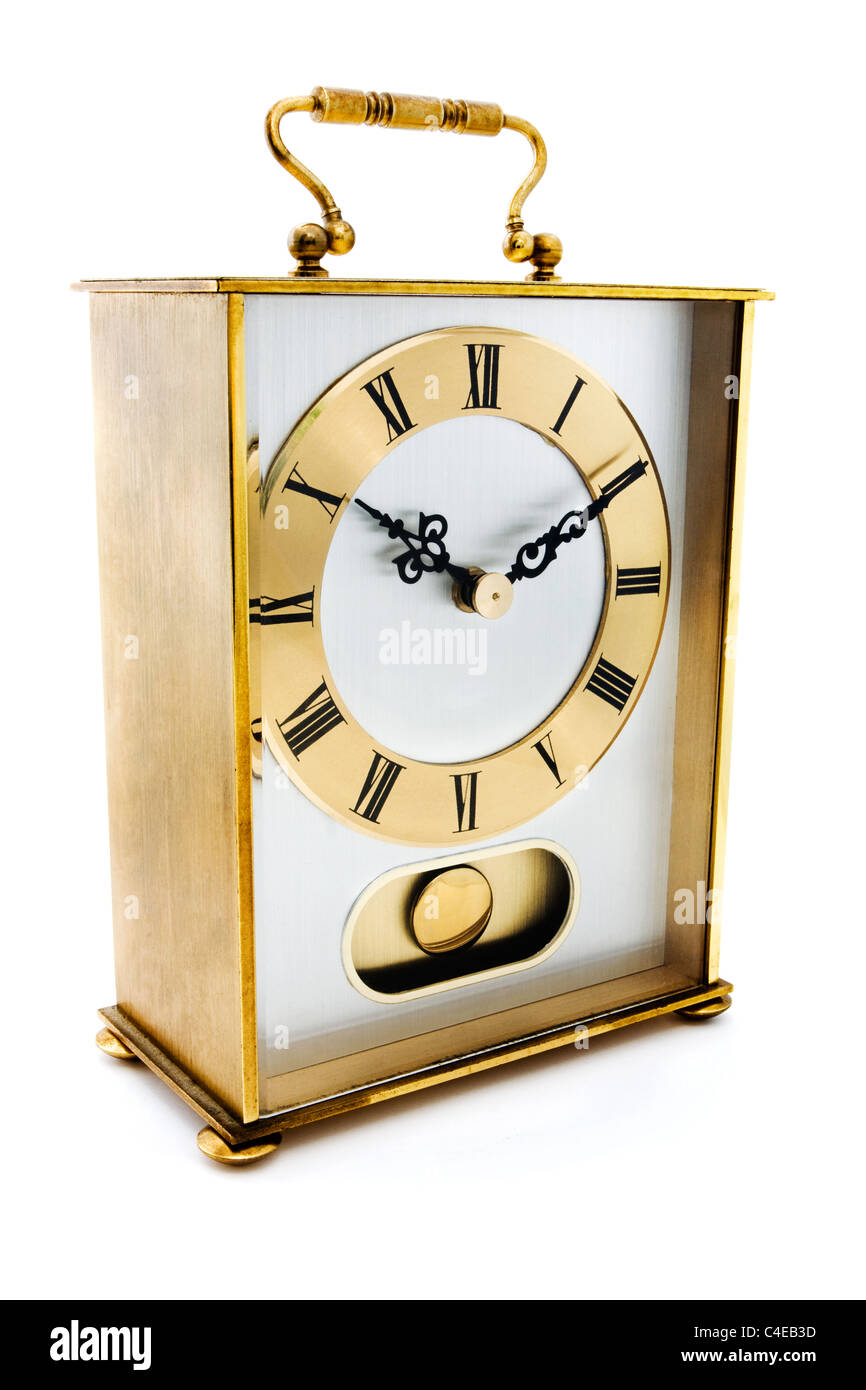 Gold carrige clock isolated on white - Stock Image