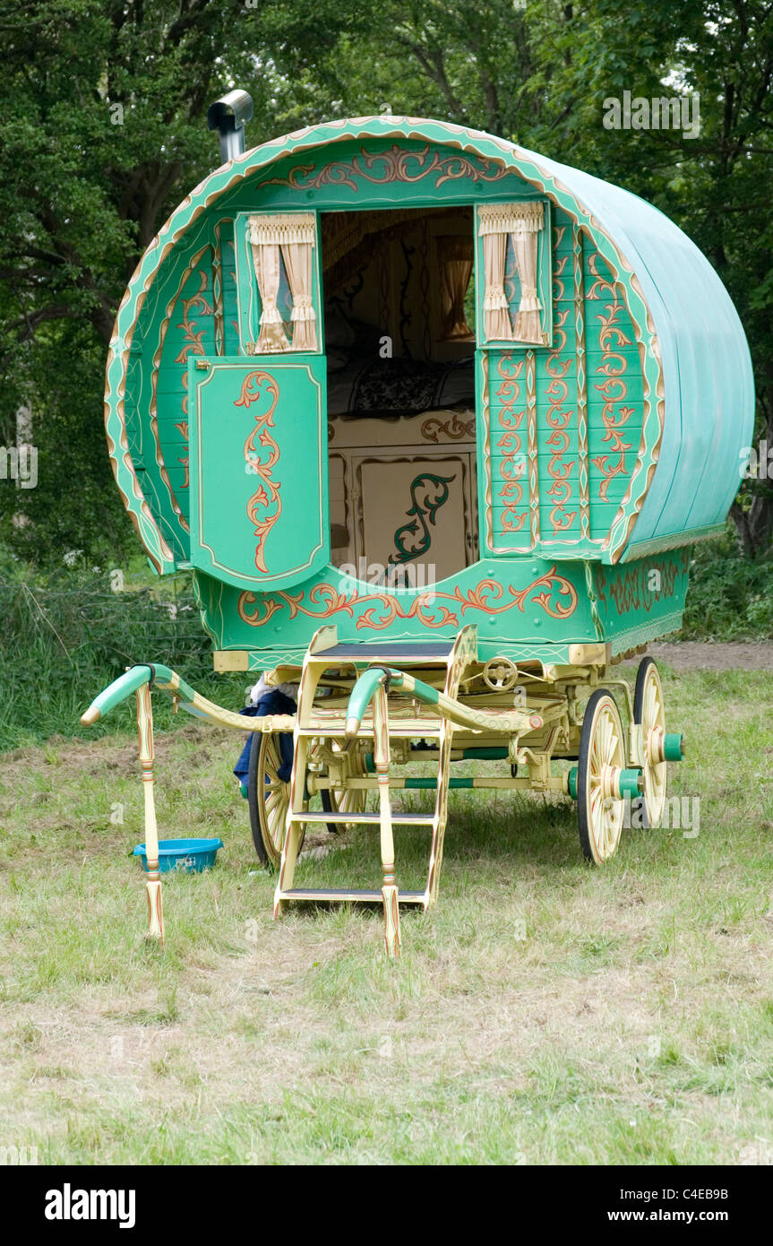 gypsy caravan caravans traditional wood wooden wheel wheels horse drawn traveler travelers  Gypsies - Stock Image