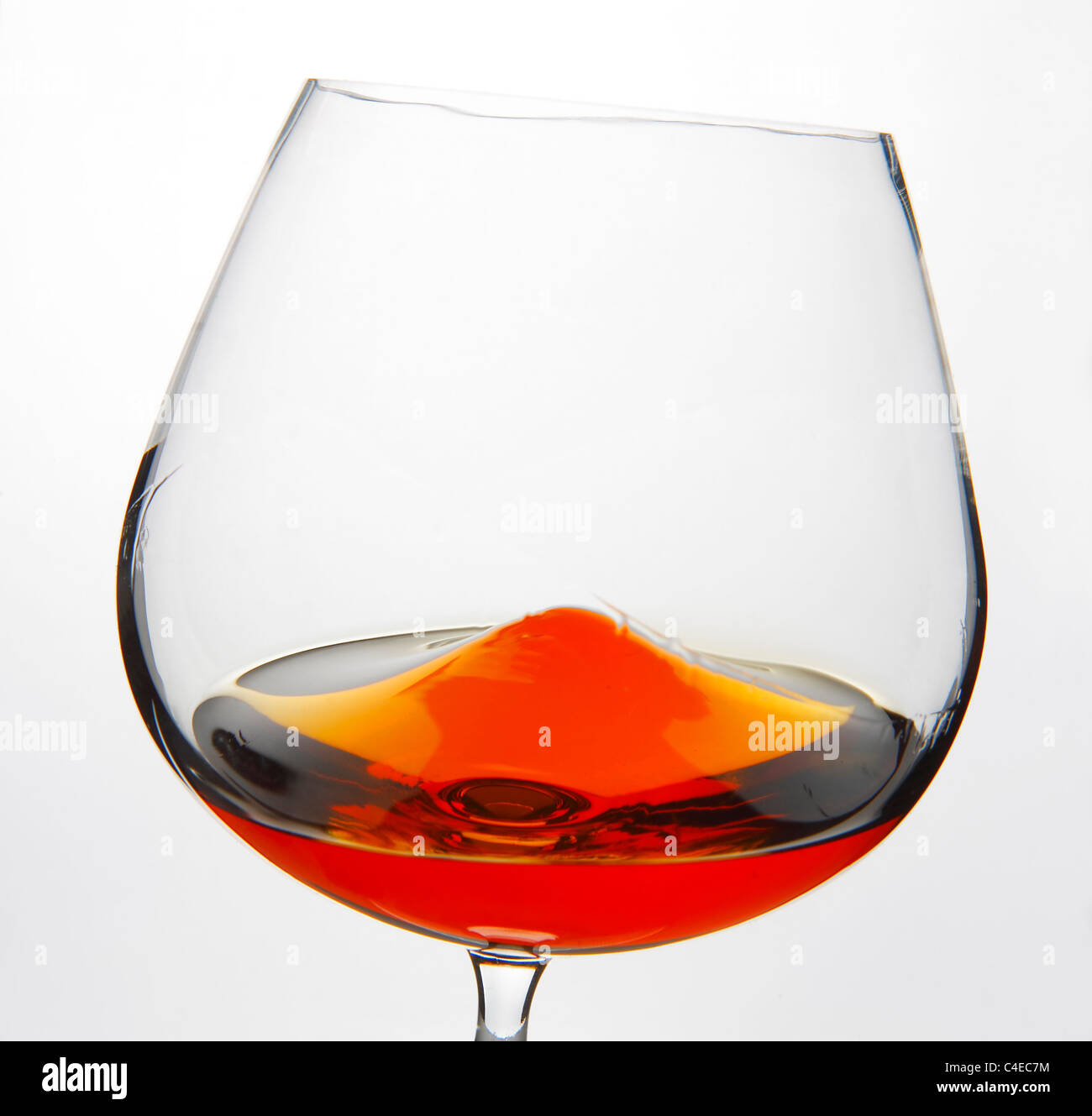 Cognac Snifter glass with liquid inside - Stock Image
