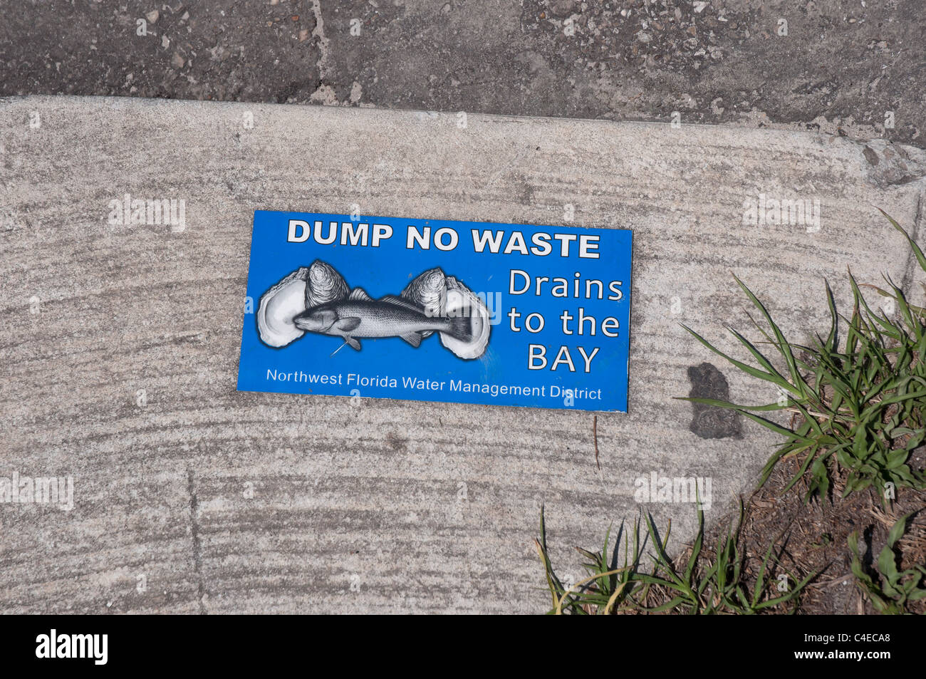 Florida Panhandle Appalachicola sign warning against polluted waste contaminating the coastal waters - Stock Image