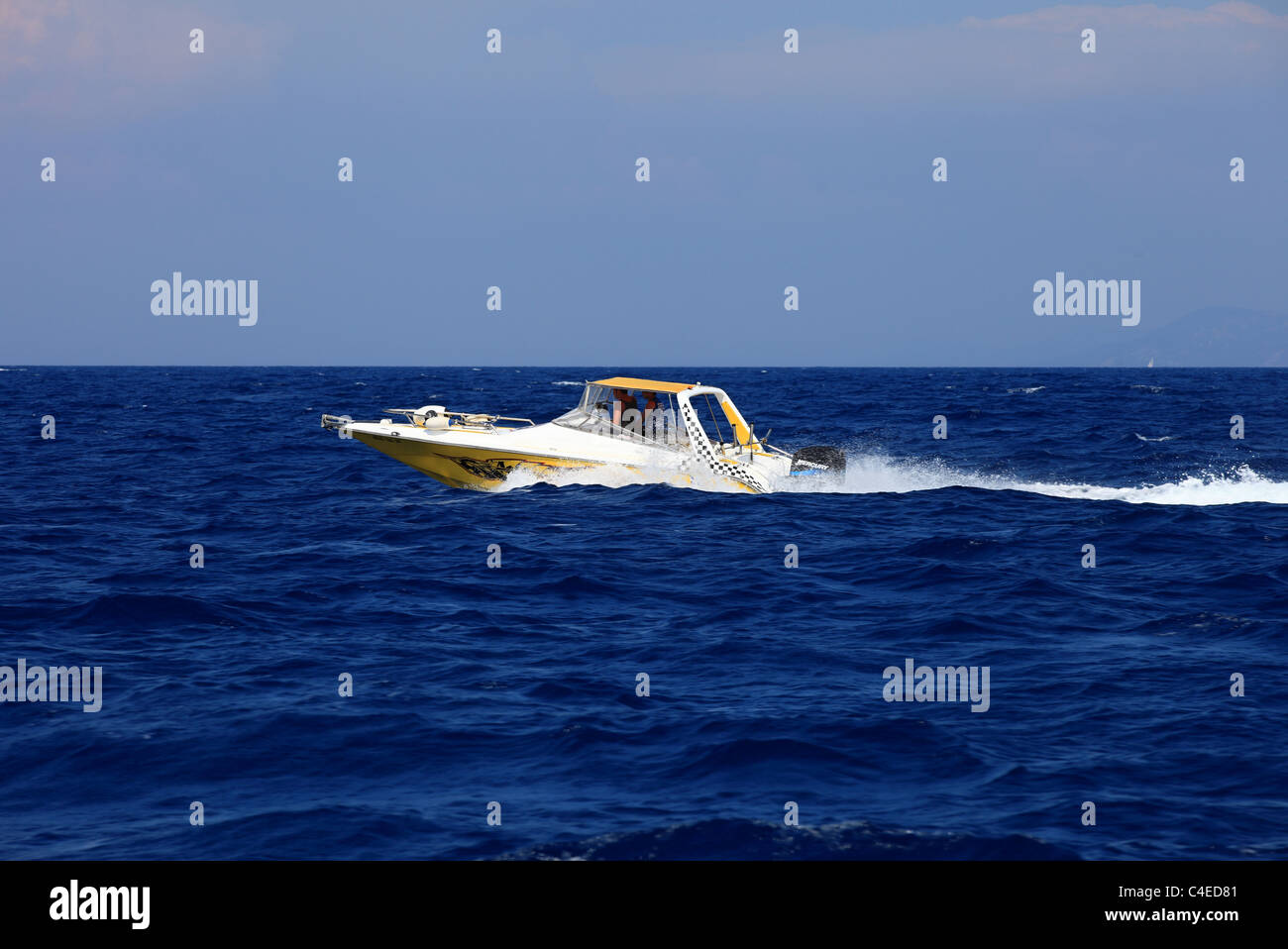Little speed boat cruising in the Aegean Sea Kos Greece - Stock Image