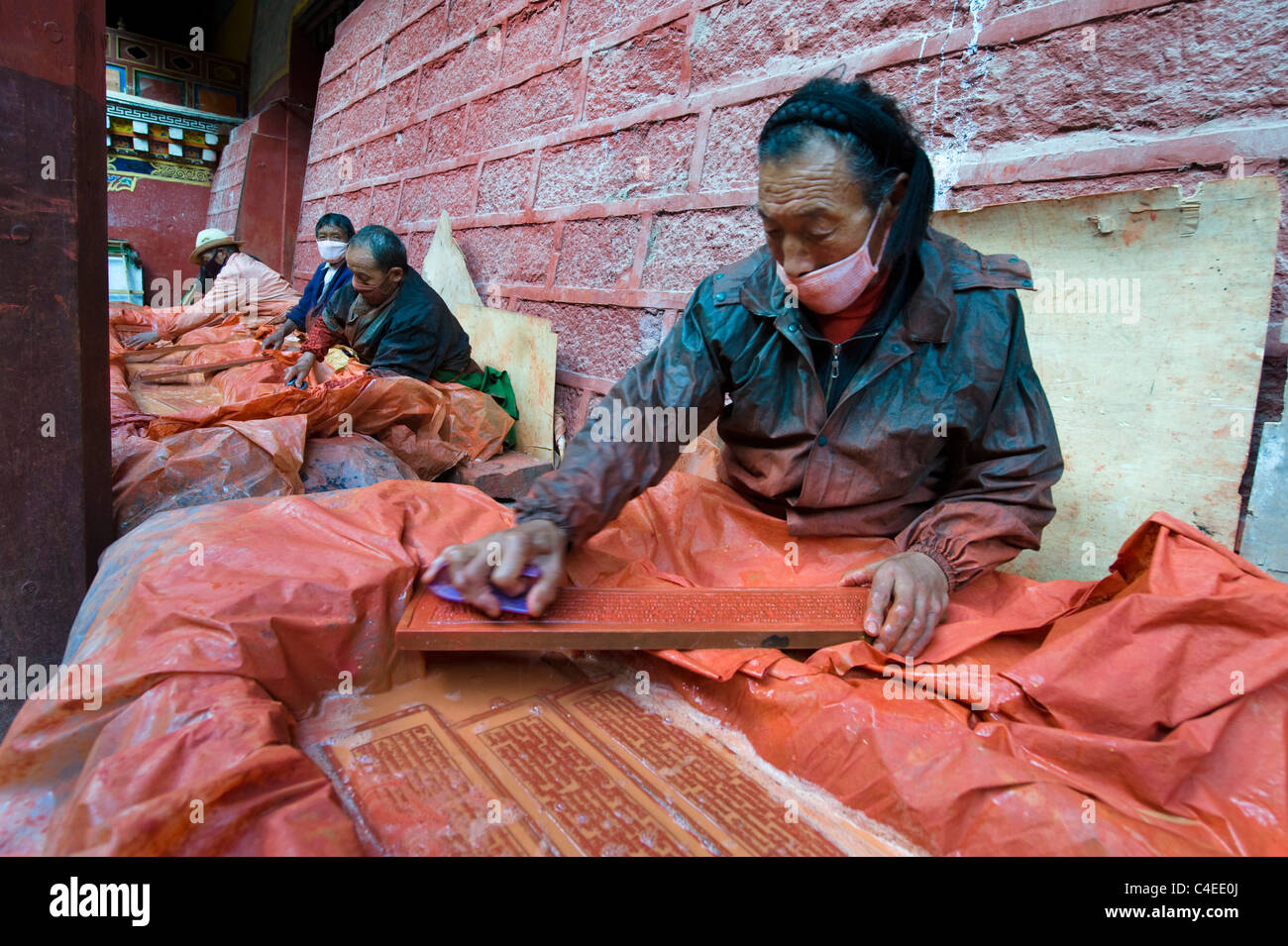 Washing and cleaning the wooden printing blocks at Dege Scripture Printing House, Dege, Sichuan, China - Stock Image