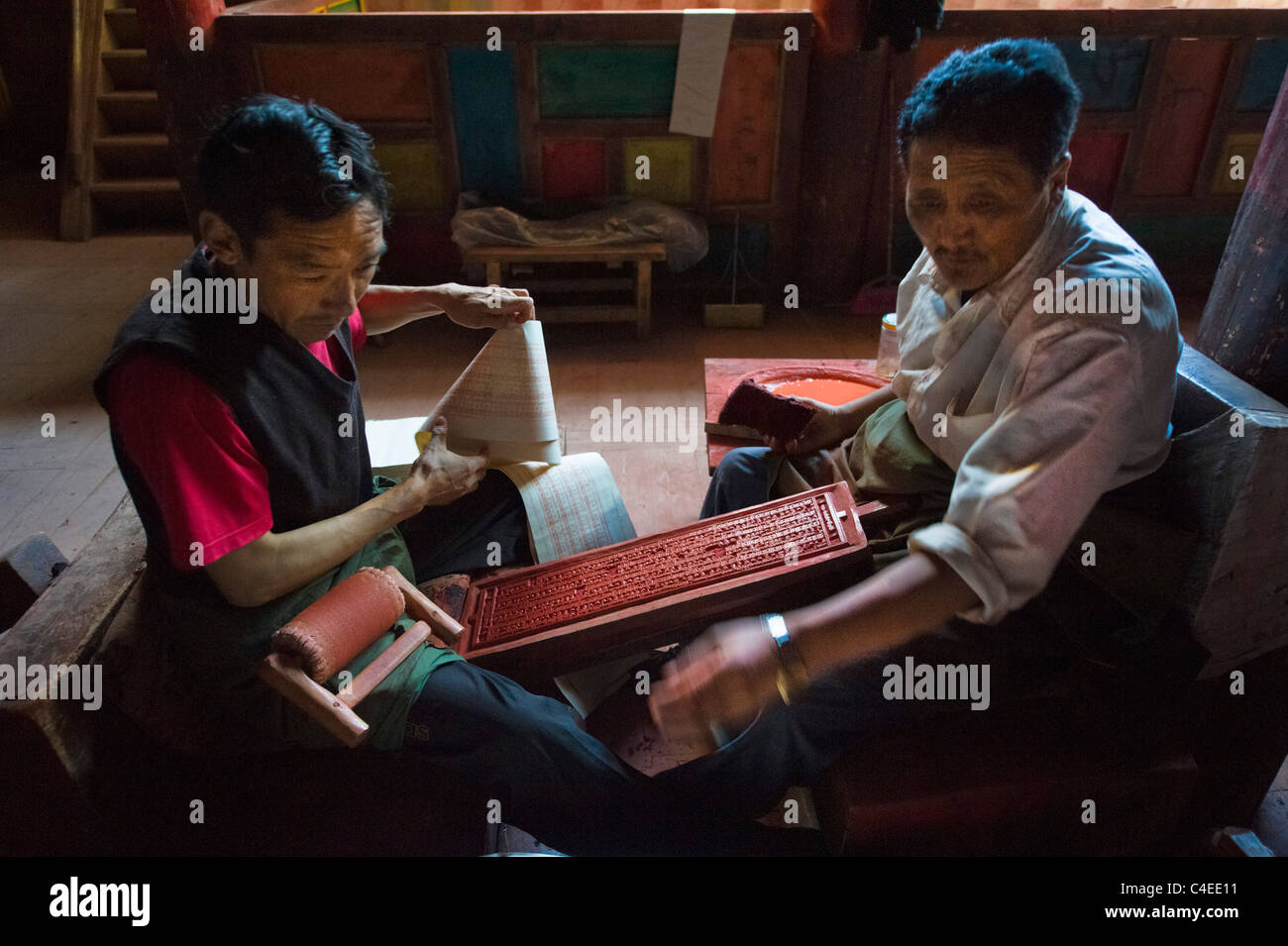 Printing from carved wooden printing blocks at  Dege Scripture Printing House, Dege, Sichuan, China - Stock Image