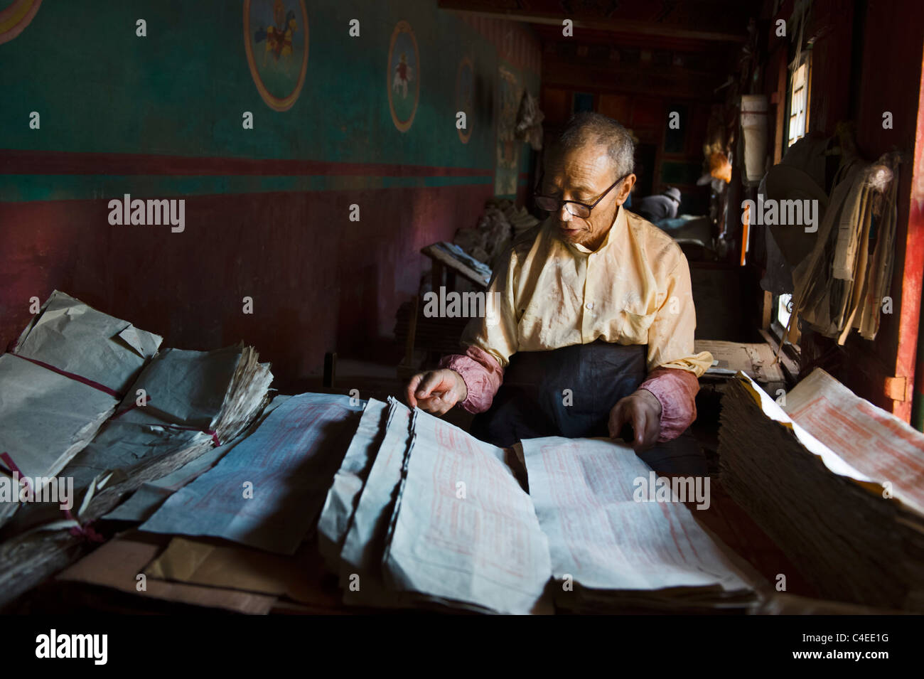checking the printed paper at Dege Scripture Printing House, Dege, Sichuan, China - Stock Image