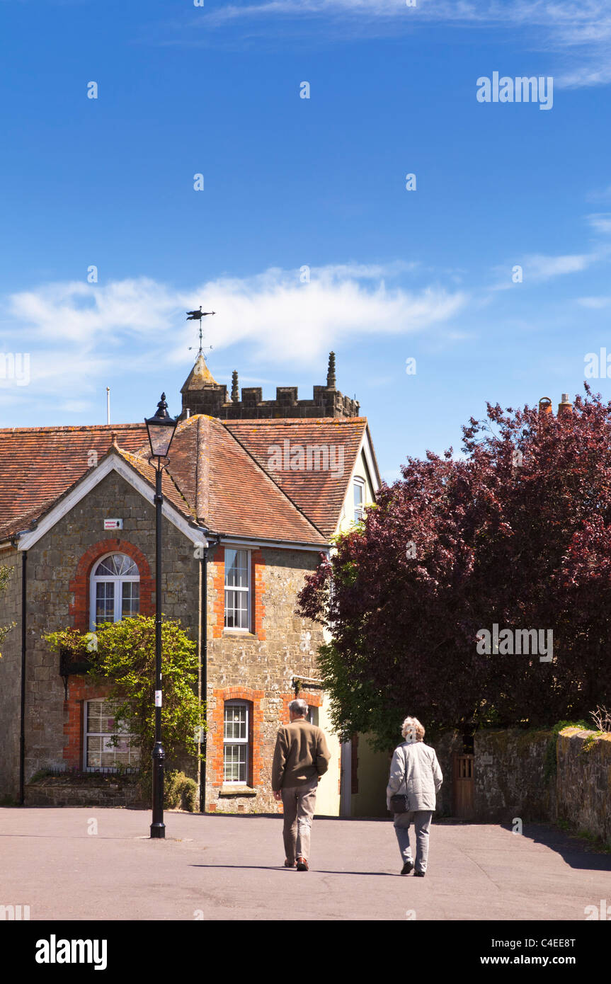 Couple walking in Shaftesbury, Dorset, England, UK - Stock Image