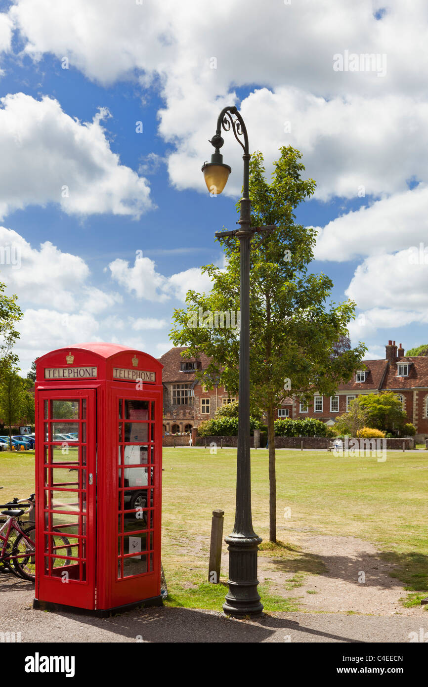 Red phone box and lamp in Choristers Square, Salisbury, Wiltshire, England, UK - Stock Image