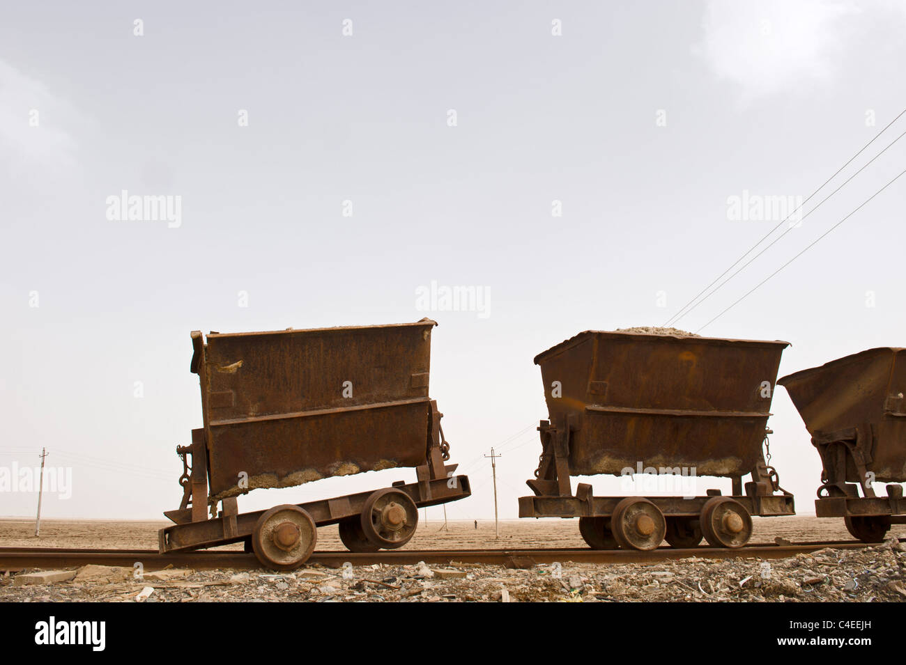 Hoppers on rail track at Chaka Salt Lake, Qinghai, China. - Stock Image