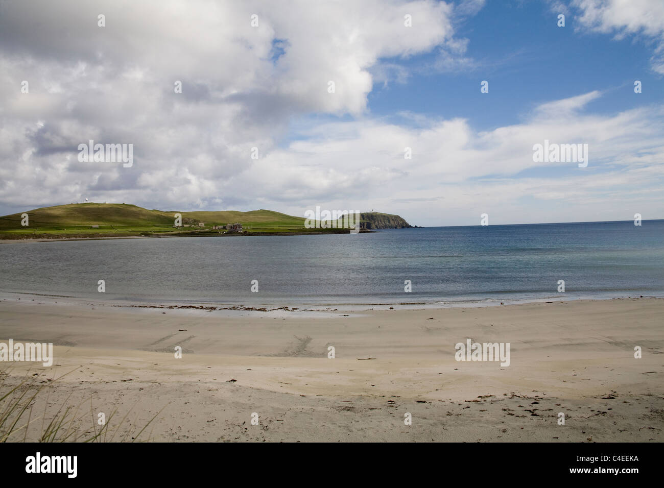Shetland Islands Scotland May West Voe Beach looking towards Sumburgh Head Lighthouse on tip Southern mainland - Stock Image