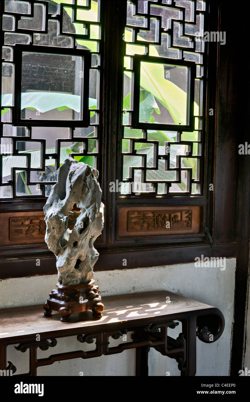 Scholars' rock displayed on a side table in the Humble Administrator's Garden (Zhuo Zheng Yuan), Suzhou, - Stock Image