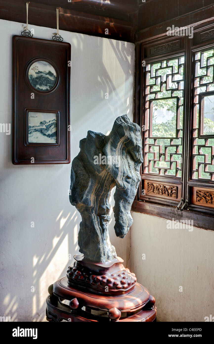 Scholars' rock displayed in the Humble Administrator's Garden (Zhuo Zheng Yuan), Suzhou, China. - Stock Image