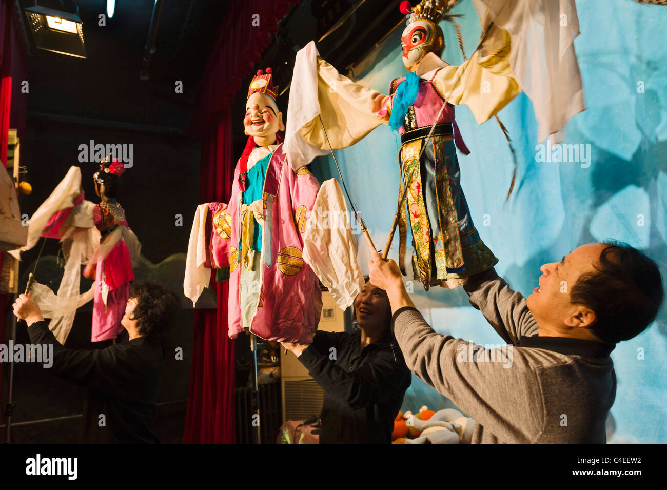Puppeteers with traditional Chinese rod puppets performing at the China Puppet Theatre, Beijing. - Stock Image