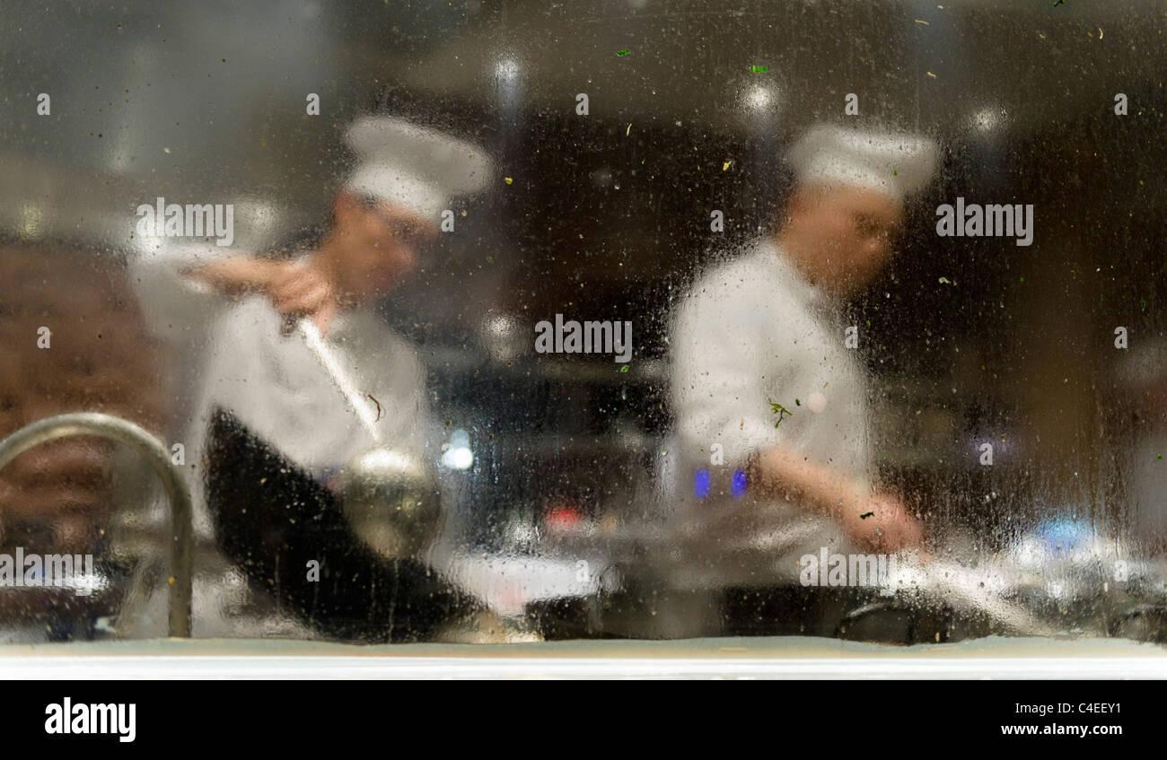 Kitchen at Xindalu restaurant, Hyatt on the Bund, Shanghai. - Stock Image