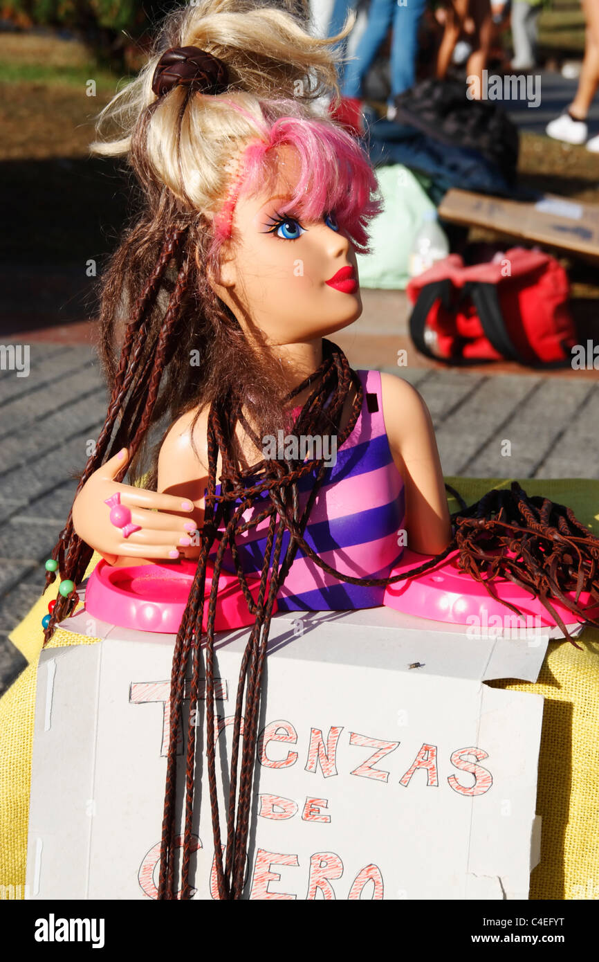 Stall offering 'Trenzas de Cuero' (leather plaits/braids) at Womad festival in Las Palmas, Gran Canaria - Stock Image