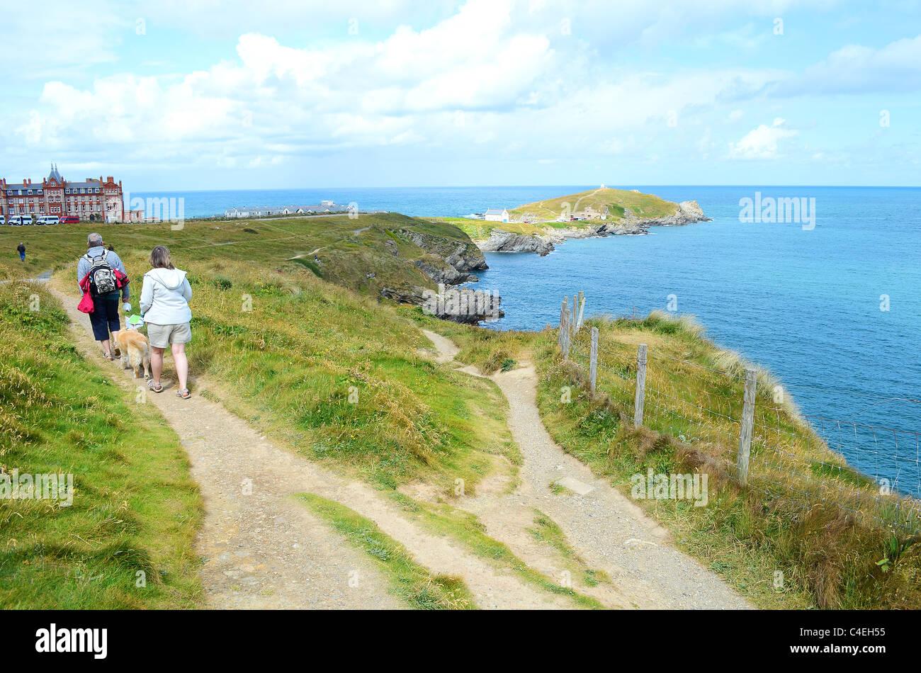 people walking the south west coast path on towan head, newquay, cornwall, uk - Stock Image