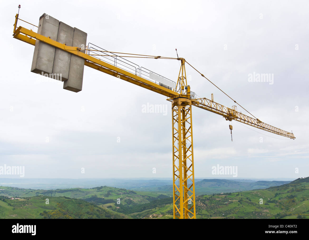 Massive concrete counterbalance weights on the boom arm of a