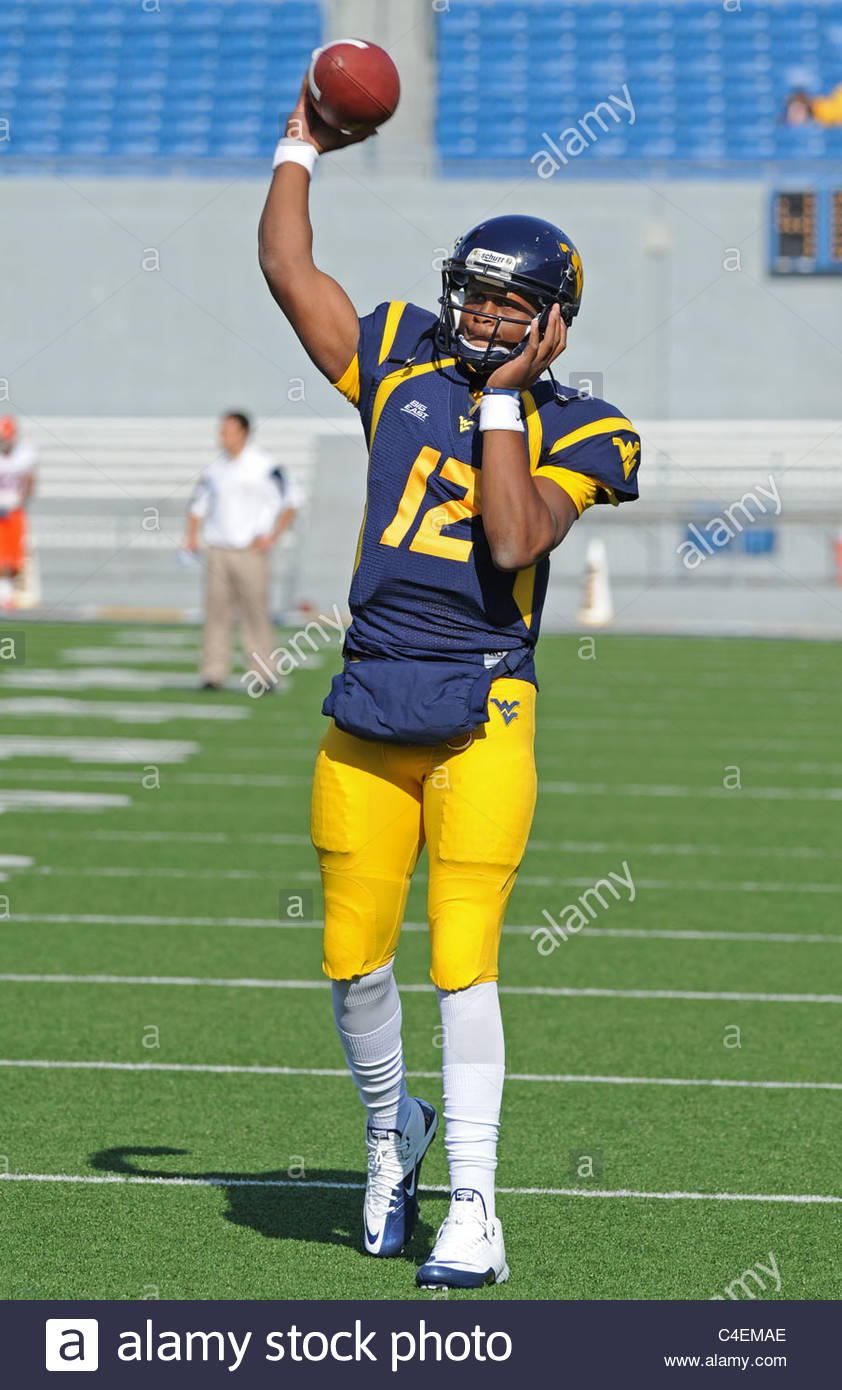 West Virginia University quarterback Geno Smith throws a football (American) during pregame drills - Stock Image