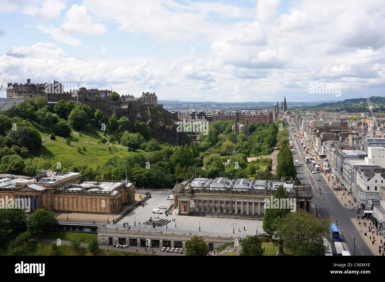 Edinburgh Castle, looking west along Princes Street with the National Galleries  (sandy coloured)  and the RSA in - Stock Image