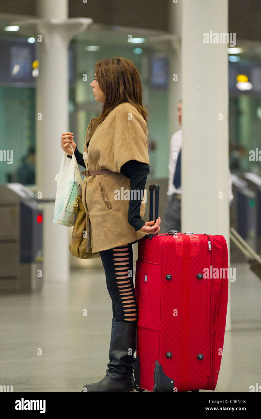 woman with luggage - Stock Image