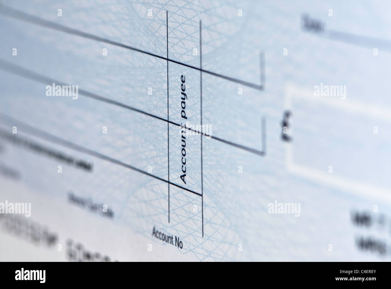 Close up of a cheque with the words 'account payee' visible. - Stock Image