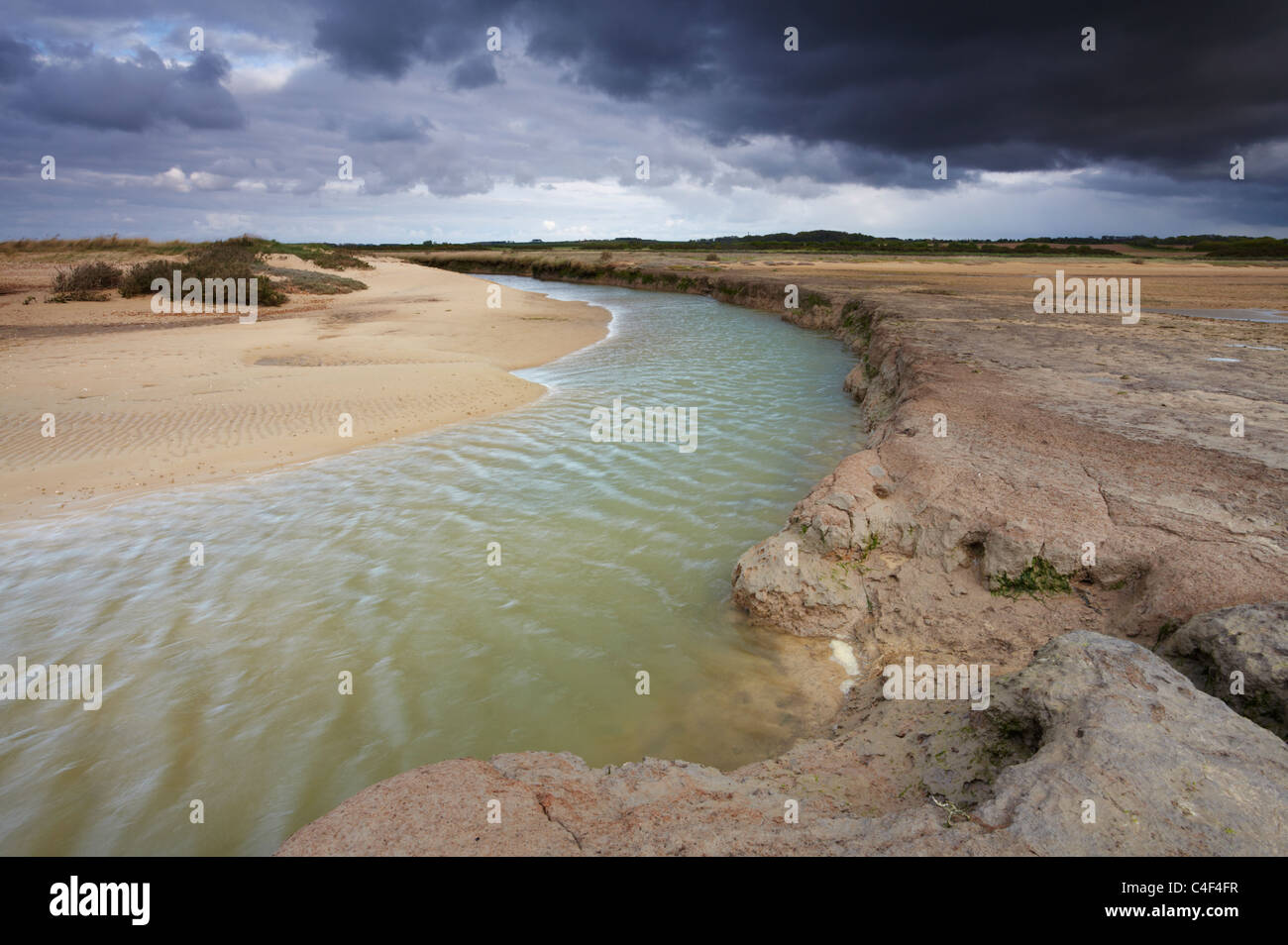 A moody spring evening on the saltmarshes and mudflats at Stiffkey on the North Norfolk Coast Stock Photo