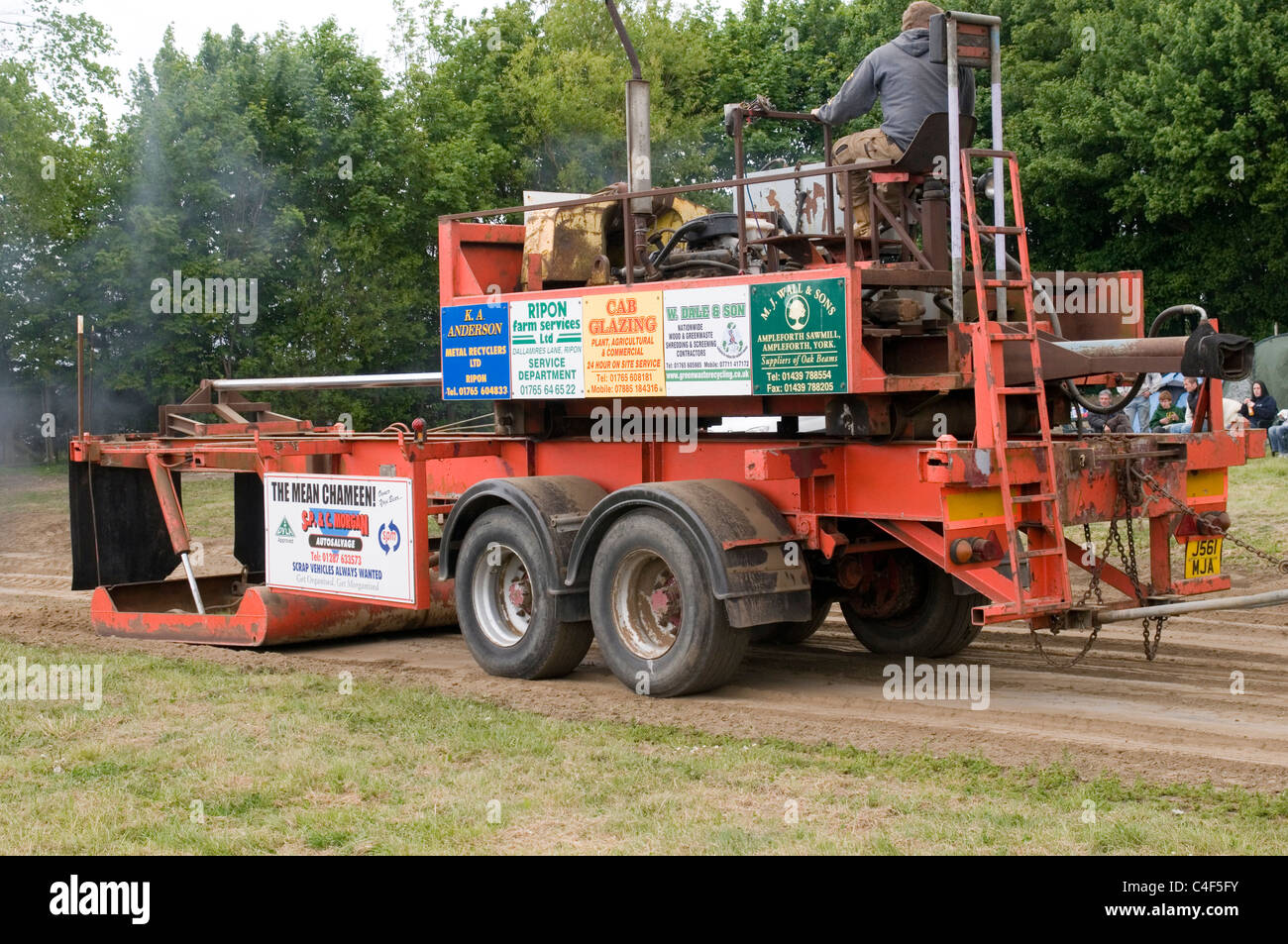 self propelled tractor pulling sled sledge - Stock Image