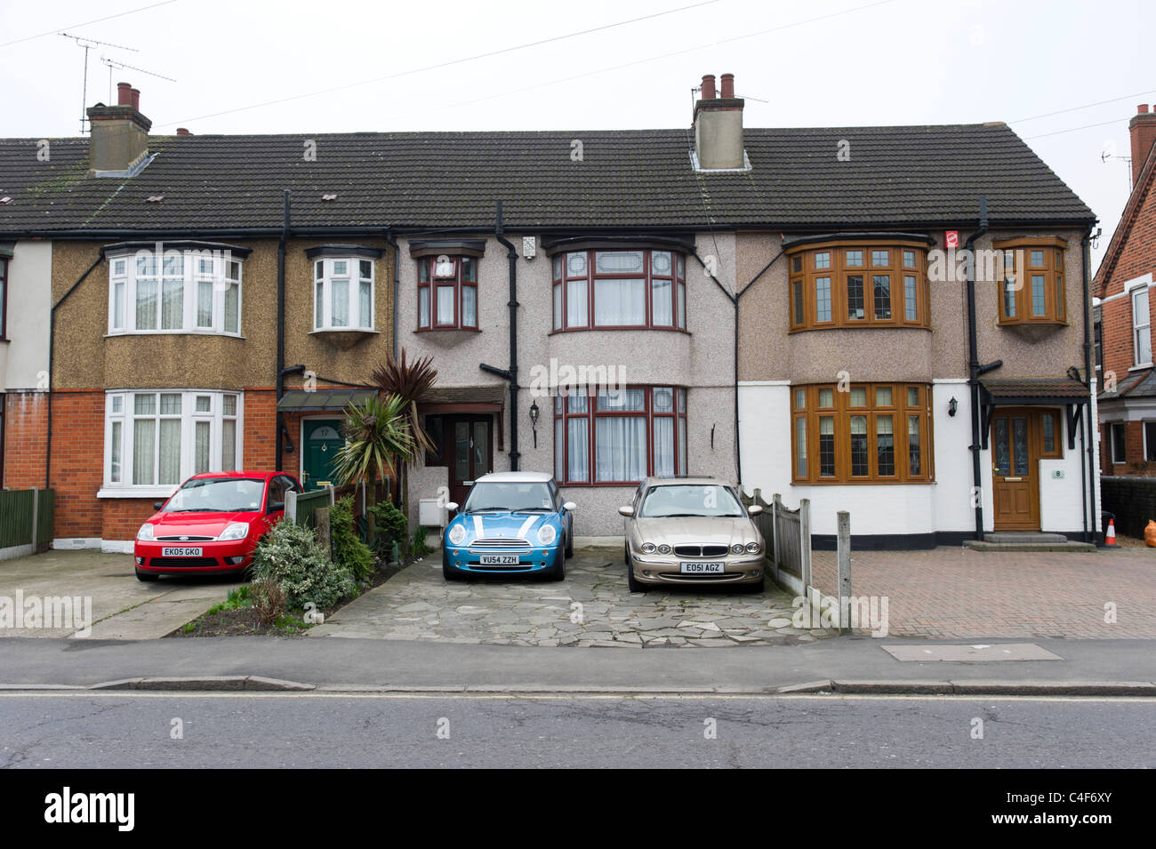 Cars parked in the front garden, Romford, London, UK - Stock Image
