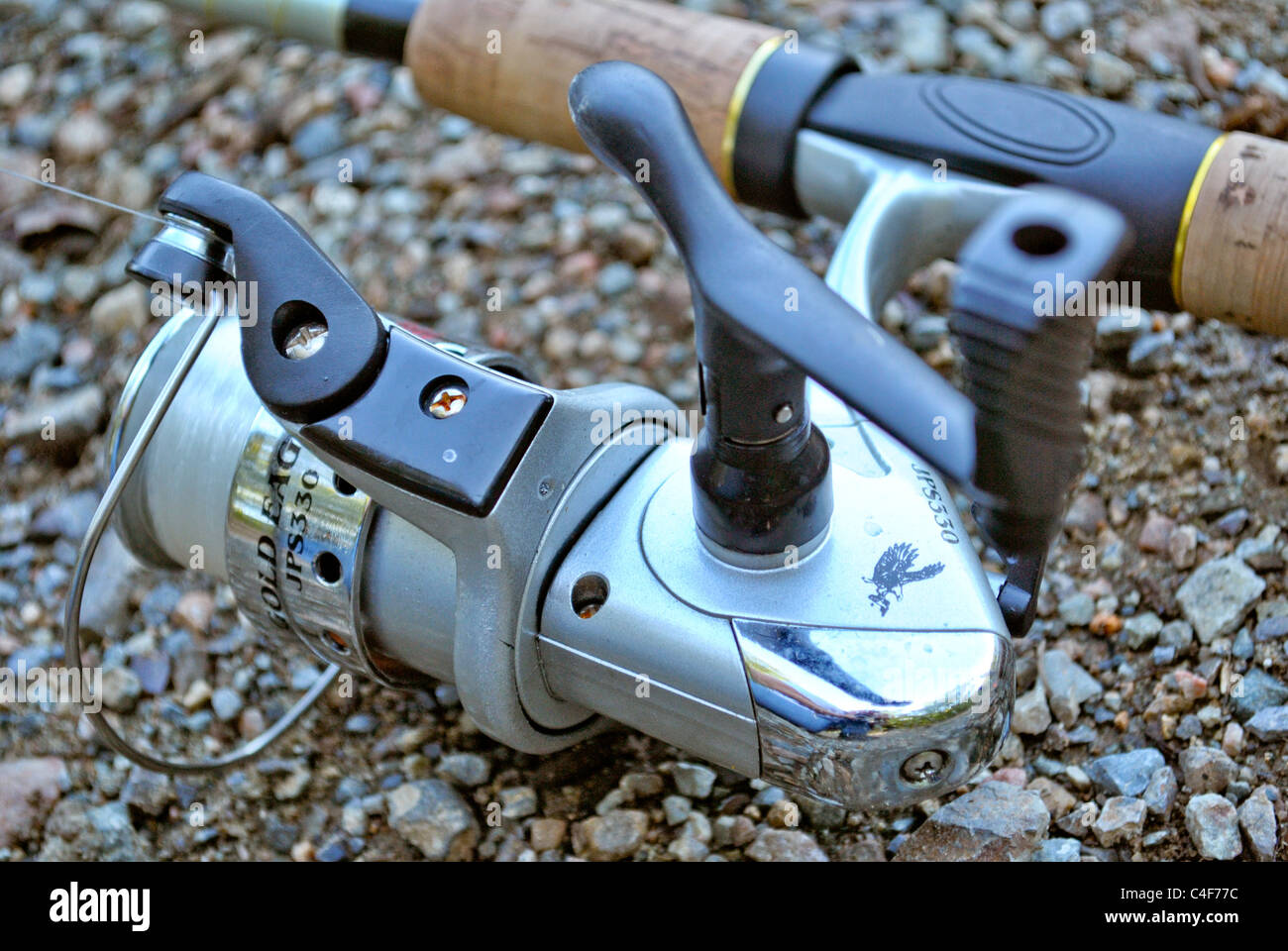 Close up of a reel of a fishing rod. - Stock Image