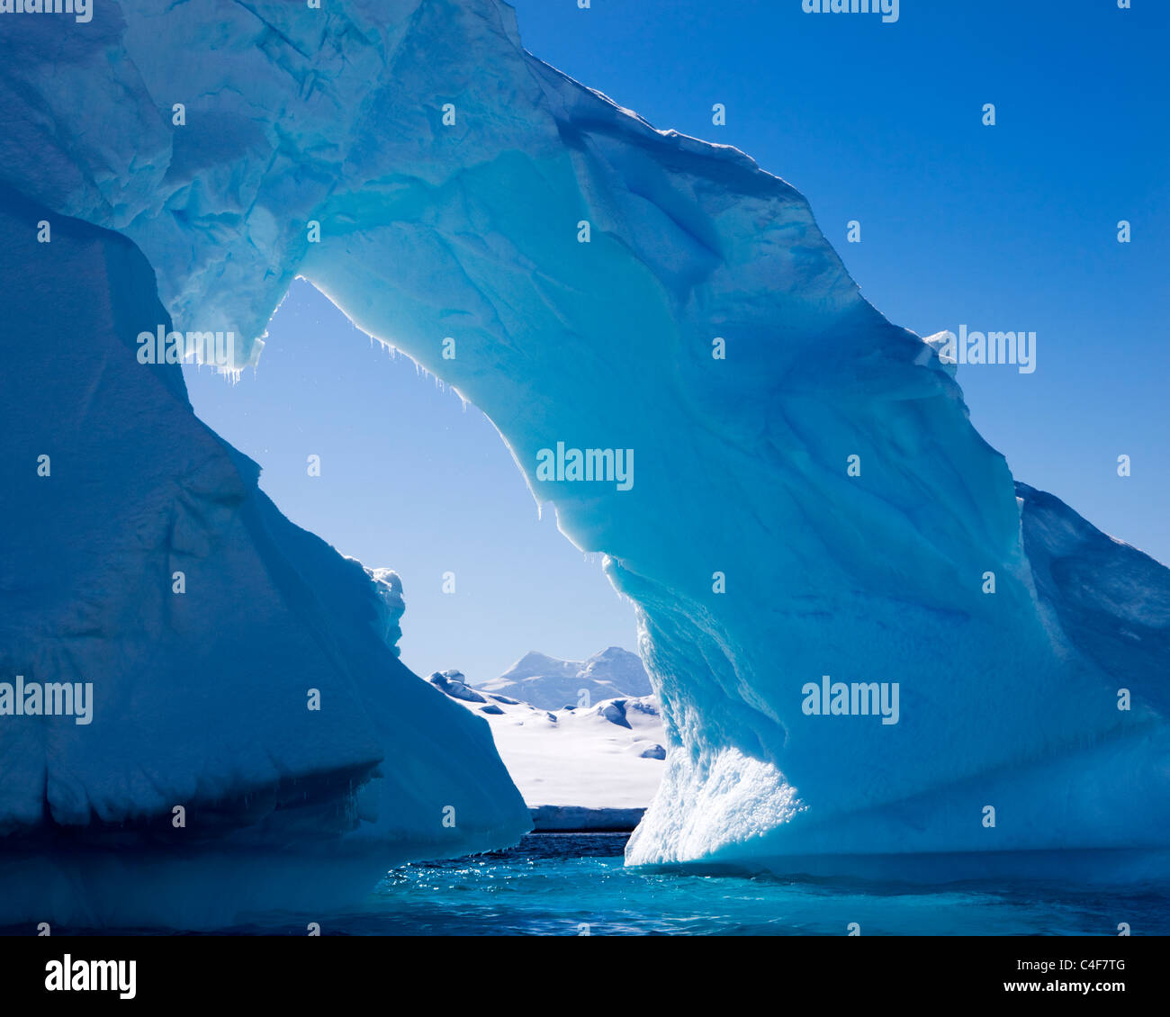 Iceberg arch, Antarctic Peninsula. - Stock Image