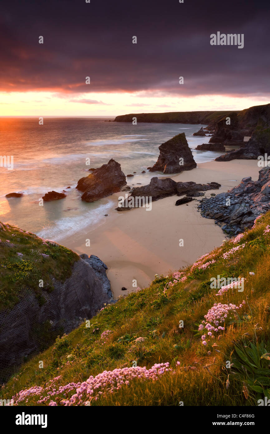 Sunset over Bedruthan Steps, North Cornwall, England. Spring (May) 2009. - Stock Image