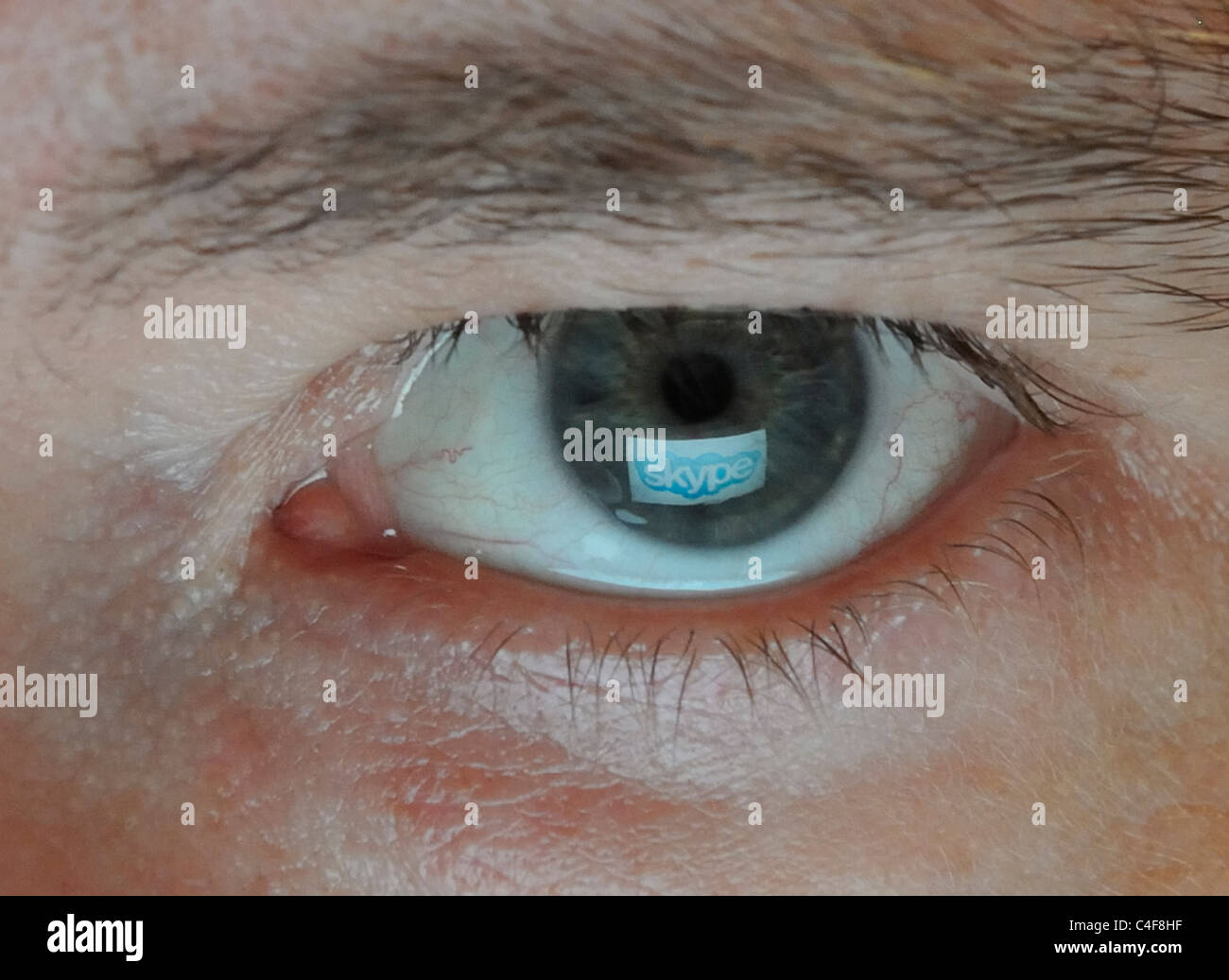 Company Logo mirrored in Eye Stock Photo